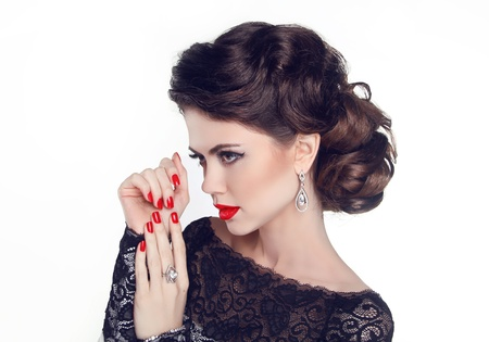Fashion Portrait Of Beautiful Girl with red nails and lips. Vogue Style Woman. Hairstyle