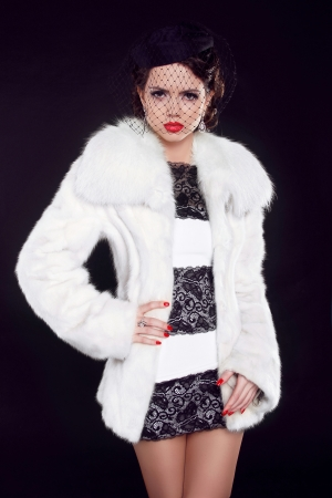 Winter Girl in Luxury Fur Coat, Fashion lady isolated on black background Stock Photo - 18184949