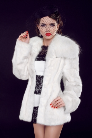 Beautiful woman in fur coat. Jewelry and Beauty. Fashion photo Stock Photo - 18184944