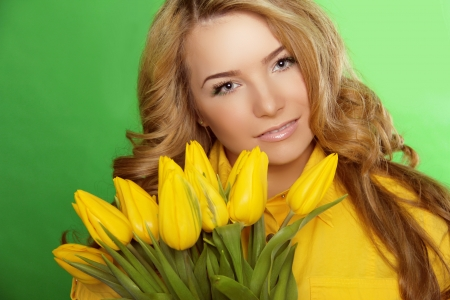 Beautiful Girl With Tulip Flowers. Beauty Model Woman Face. Perfect Skin. photo