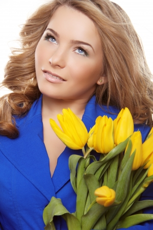Beautiful woman portrait with tulips looking up Stock Photo - 18351631