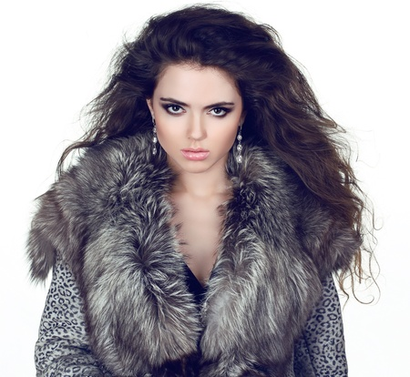 Elegant Girl in Luxury Fur Coat isolated on white background. photo