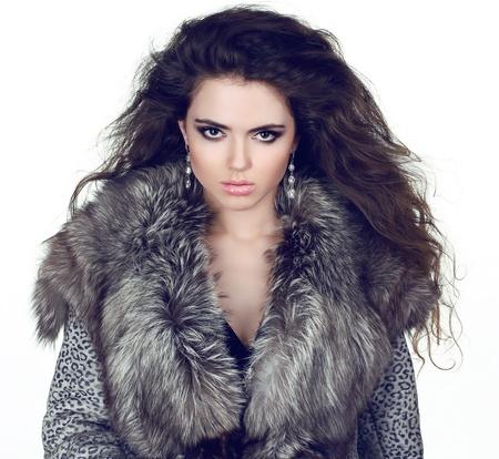 Elegant Girl in Luxury Fur Coat isolated on white background. Stock Photo - 18351603