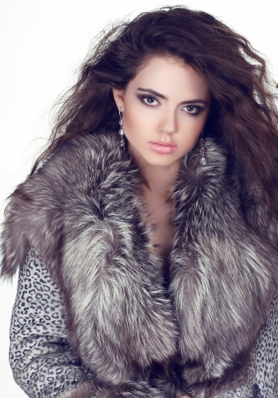 Beautiful woman in Luxury Fur Coat. Fashion Fur photo