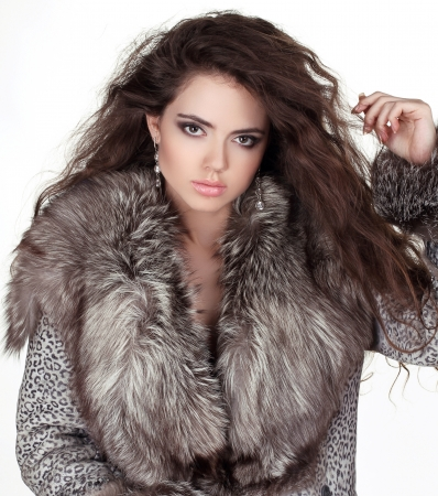 Beautiful young woman in Fur Coat. Fashion Fur photo