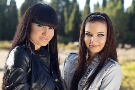 sisters sexy: Two women. Closeup of beautiful young girls, outdoors portrait