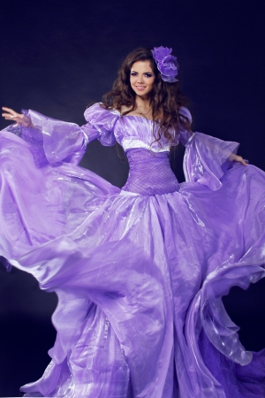 Fairy. Beautiful Girl in gorgeous dress, motion shot. Fancy-dress ball photo