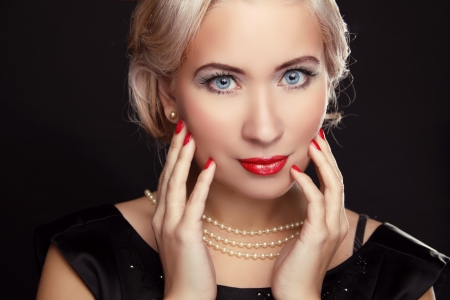 Close up of blue eyes. Retro woman with make up and red nails photo