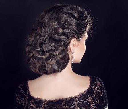 Hair. Wavy Hairstyle. Beautiful Brunette Girl. Curly Hair. photo