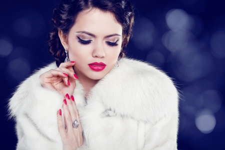 Beautiful woman with evening make-up in fur coat. Jewelry and Beauty. Fashion photo photo