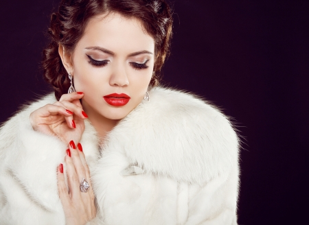 Glamour portrait of beautiful woman model  in luxury fur coat over black Stock Photo