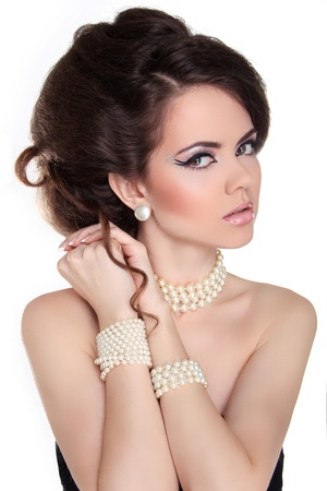 Beautiful woman with evening make-up. Jewelry and Beauty. Stock Photo - 18665413