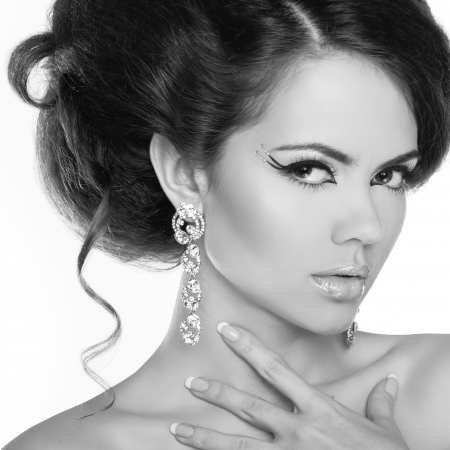 earring: Glamour portrait of beautiful woman model with makeup and romantic wavy hairstyle.