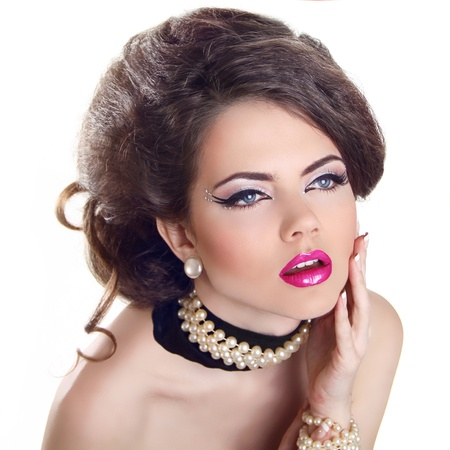 Glamourous closeup female portrait. Fashion evening elegance eyeliner makeup on model eyes. Cosmetics and make-up photo