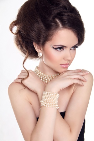 Pearls. Beautiful woman with evening make-up. Jewelry and Beauty. Fashion photo