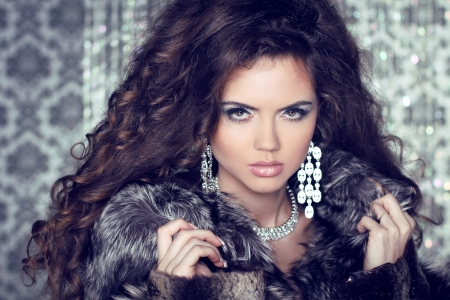 Jewelry and Fashion lady. Beautiful Woman wearing in Luxury Fur Coat over