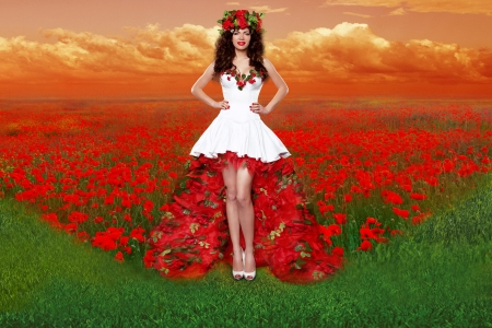Outdoors portrait of Beautiful young woman wearing in red rose dress opened flowers field photo