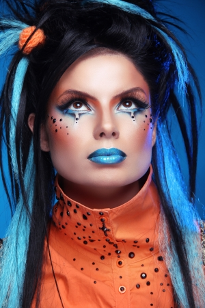 Close up portrait of Rock girl with Blue Lips and black Hair Styling with colored strand of hair. photo