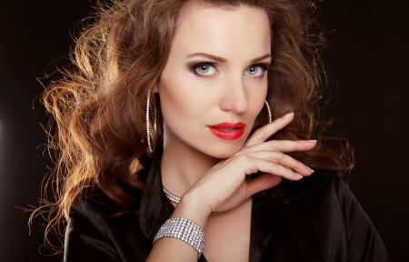 Jewelry and Beauty. Beautiful woman with curly hair and evening make-up. Fashion art photo photo