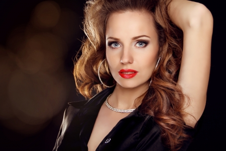 Portrait of Beautiful woman with curly hair and evening make-up. Jewelry and Beauty. Fashion art photo photo
