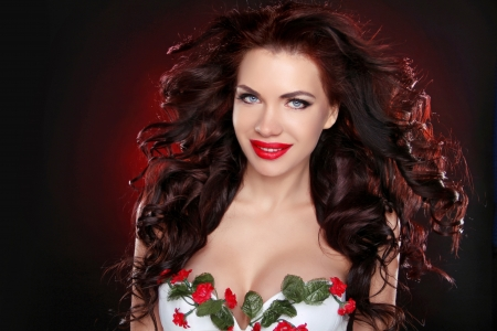 long red hair woman: Portrait of sexy brunette girl with professional make-up and hairstyle over dark background