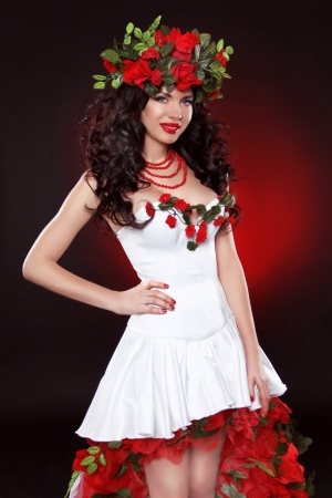 Portrait of beautiful girl with wreath of flowers. Professional make-up and wavy hairstyle photo