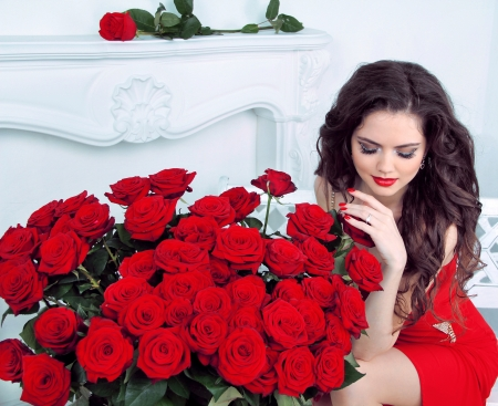 Beautiful young woman with red roses flowers bouquet in modern interior apartment Stock Photo - 19399167