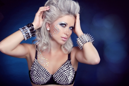 Beautiful rock woman with hair styling and evening make-up photo