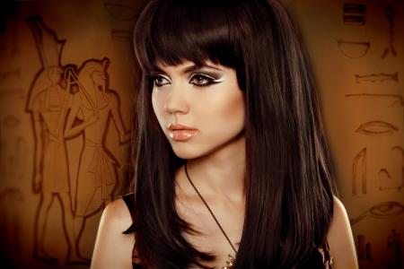 scribes: Hair. Beautiful Brunette Girl over Egyptian hieroglyphs
