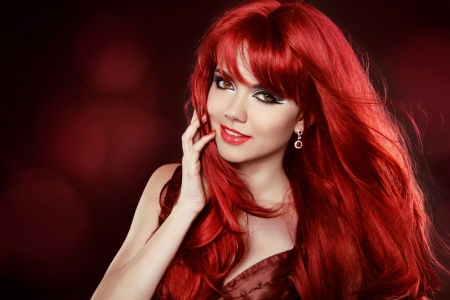 Portrait of Beautiful Girl With Healthy Long Red Hair and Makeup photo