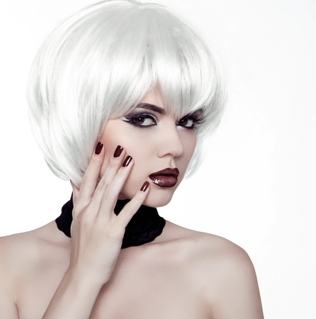 Fashion Style Woman. Beauty Woman Portrait with White Short Hair. Hairstyle. Manicured polish nails. photo