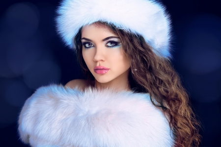 Beautiful Girl in Fur Coat and Furry Hat. Fashion Model. Winter Woman Portrait