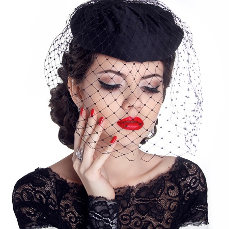 Retro woman portrait in hat isolated on white background. Makeup. Red lips and polish nails. photo