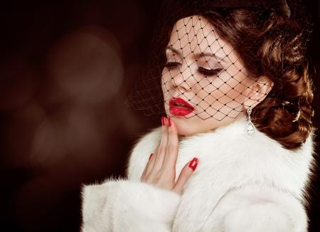 mink: Retro lady portrait. Beautiful Woman in Luxury Fur Coat. Coquette Stock Photo
