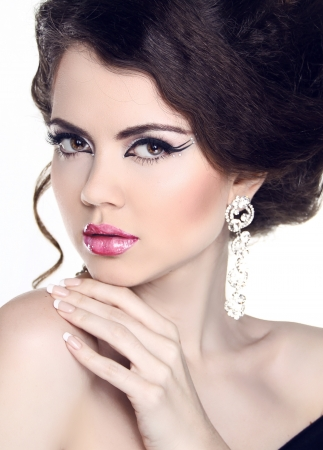 Fashion Beauty Woman Portrait. Manicure and Make-up. Hairstyle. Jewelry