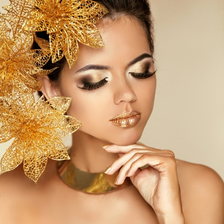 eye lashes: Eye Makeup. Beautiful Girl With Golden Flowers. Beauty Model Woman Face. Perfect Skin. Professional Make-up. Fashion Art Photo Stock Photo