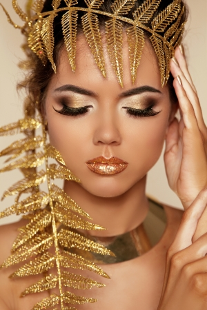 egypt: Eye Make up. Beautiful Make-up Closeup. Eyeshadow. Professional Makeup. Golden Makeover.