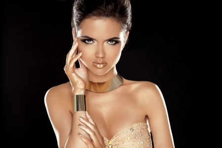 Vogue Style. Glamour Lady. Fashion Beauty Girl with Golden Jewelry. Luxury Woman Portrait.  photo