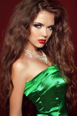 Beauty Portrait. Elegant Woman with Red Lips and Very Long Brown Hair. photo