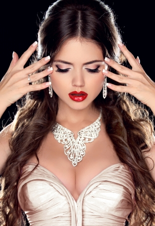 Beautiful Bride. Fashion Beautiful Girl Model with Jewelry isolated on black background. Jewelry. Makeup. Hairstyle. Zdjęcie Seryjne