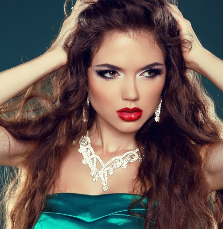 Makeup. Beautiful brunette woman with red lips. Sexy Girl with Jewelry. Stock Photo - 22012222