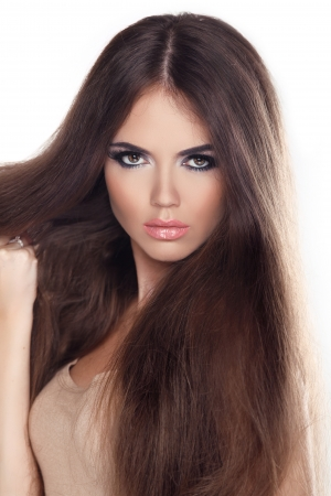 Beautiful woman with long brown hair. Closeup portrait of a fashion model posing at studio. Stock Photo - 22183270