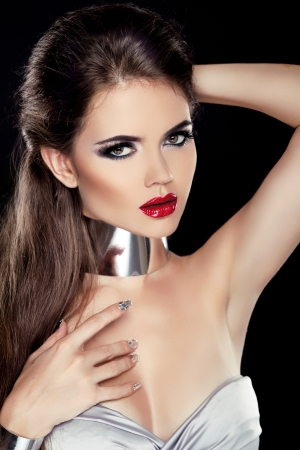 Beautiful Brunette Woman with Red lips isolated on black background. Fashion Beauty Girl. photo