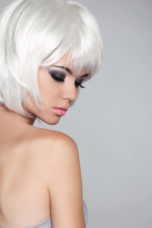 Fashion Beauty Portrait Woman. White Short Hair. Isolated on Grey Background. Beautiful Girl's Face Close-up. Haircut. Hairstyle. Fringe. Make-up. Vogue Style. Stock Photo - 22183301