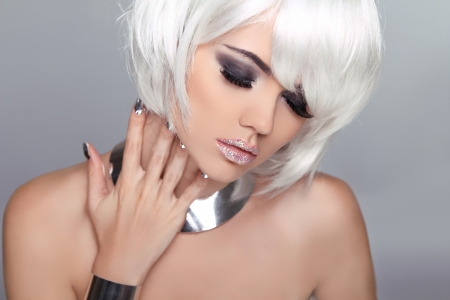 Fashion Beauty Blond Girl. Woman Portrait with White Short Hair. Hairstyle. Make up. Vogue Style. photo