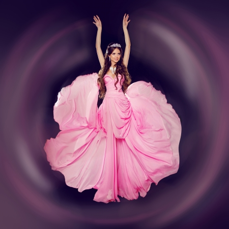 Fashion art photo of young beautiful woman in blowing dress.  photo