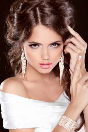 Beauty Bride. Beautiful elegant brunette girl, fashion model posing. Make up. Hairstyle. Jewelry. Studio Photo photo