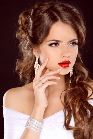 flaxen: Elegant girl with red lips. Beautiful Woman. Hairstyle. Makeup. Manicured nails. Fashion girl isolated on black background