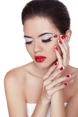 Eyeliner. Beauty girl. Eye Makeup. Manicure and Red Lips. Fashion Make-up and Manicure. Isolated on white background Stock Photo - 22348731