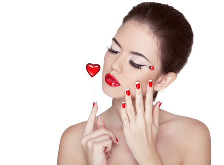 Beauty Vogue Style Fashion Model Girl with Long Lushes. Manicured nails and Red Lipstick. Isolated on a white Background. photo